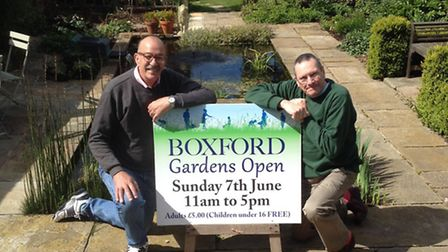 Getting the message across! John Kirby and Joe Barrett by their pond - with a board advertising the