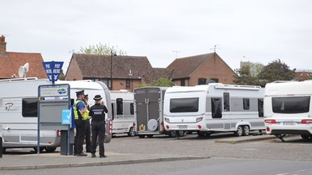 The scene earlier when travellers parked up at a supermarket in Woodbridge.