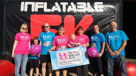 Archie Colman completed an inflatable 5K run in October with his dad Steve Colman and aunties. PHOTO