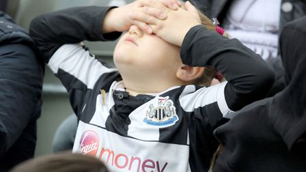 A young Newcastle fan reacts during a Barclays Premier League match at St James' Park, Newcastle. Pi