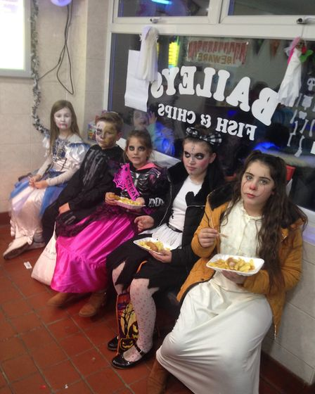 Local youngsters in Halloween fancy dress who recieved free meals at Baileys Fsh and Chip shop in Di