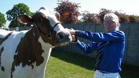 Louise Smith of Smith Farms, Clacton, with her family's Any Other Pure Dairy Breed champion