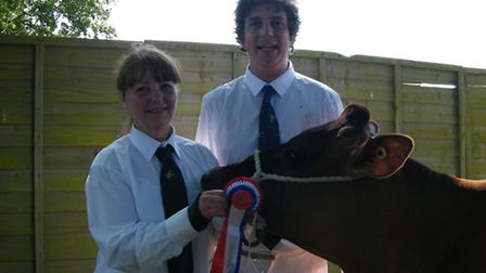 Christine and John Smith of Smith Farms, Clacton, with the family's Jersey breed champion
