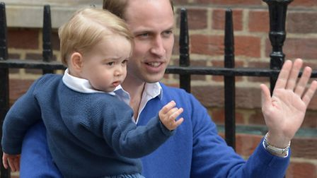 The Duke of Cambridge with his son Prince George as he arrives at the Lindo Wing of St Mary's Hospit