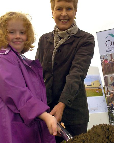 Ruth in Elmswell, cutting the first sod in a new housing development with Jordan Miles, then eight,