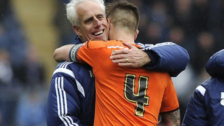 Mick McCarthy gives his captain Luke Chambers a hug after the game at Blackburn