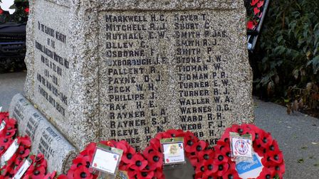 Wreaths laid at Harleston war memorial marking the cententary of the First World War armistice. Pict