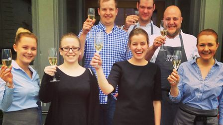 The team at the Long Melford Swan celebrate its new food and accommodation ratings from the AA.