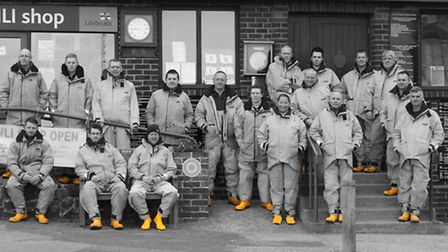 The current Walton & Frinton lifeboat crew in a special photo highlighting their yellow wellies as p