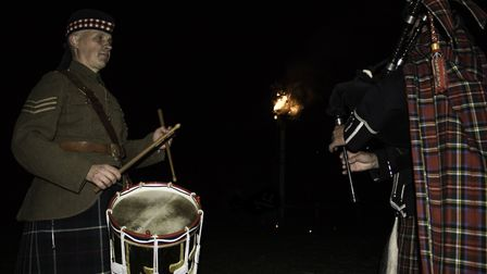 Piper playing Battles Over at Norfolk Tank Museum in Forncett after a flaming arrow lit the Battles