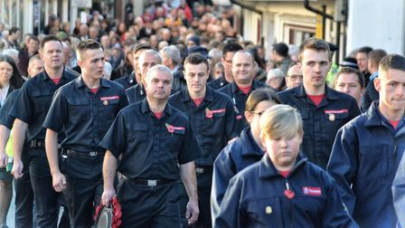 Norfolk fire service personel joined the Remembrance Day parade through Diss before to pay their re