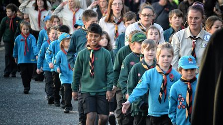Youngsters from local scout and guide groups joined the Remembrance Day parade through Diss before t