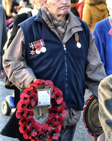 Hundreds joined the Remembrance Day parade through Diss before to pay their resp[ects and mark the c