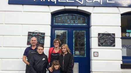 Rachael and Jamie Aitken, who are taking over The Angel Cafe in Diss, with their children. PHOTO: So