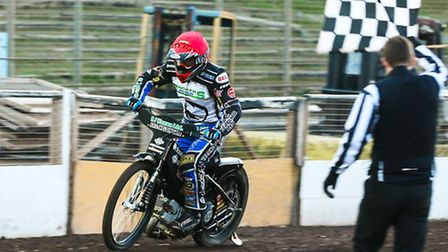 Danny King takes the checkered flag to win heat one of the Ipswich v Rye House (League Cup) meeting
