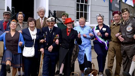 Celebrating the VE Day anniversary in Sudbury with members of the ephemera group dressing the part
