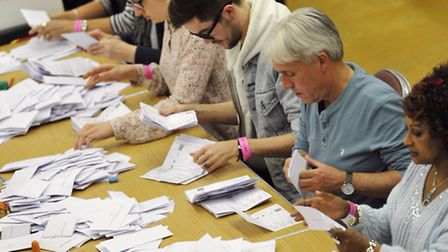 The first ballot boxes are emptied to be sorted in Colchester Leisure Centre.