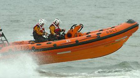 Lifeboat tows stricken vessel.