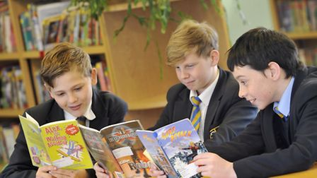Pupils Mitchell Simpson, James Fulford and Harry Boutell read books to then take quizzes at Manningt