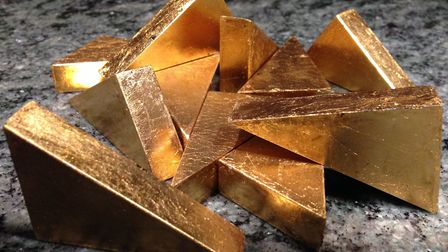 The golden triangles that have been hidden in shops as part of a treasure hunt in Diss Heritage Tria
