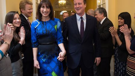 Prime Minister David Cameron and his wife Samantha are applauded by staff upon entering 10 Downing S