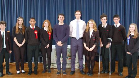 General election candidates Jack Abbott (centre left) and Dan Poulter with students at Debenham High