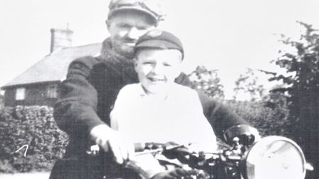 John Appleton, aged seven, with the postman from Benhall Green, Ted Ayden