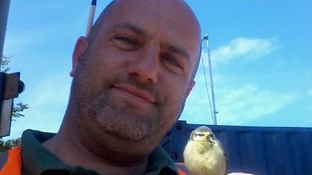 Adrian Scotcher with one of the blue tit chicks.