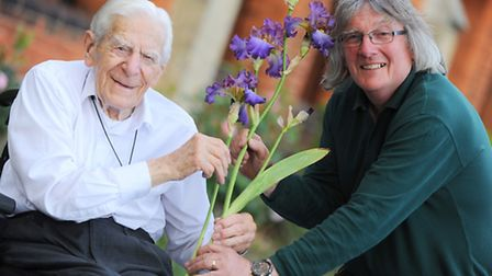 Norman Smith (left) is presented with the iris named after him by Barry Emmerson, president of the B