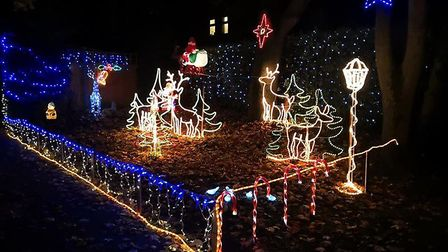 Harry Partridge has switched on his popular annual display in Skelton Road, Diss, in aid of Great Or
