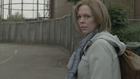Olivia Colman plays Julie, organiser of the neighbourhood watch, in the big screen adaptation of the