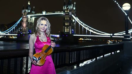 Suffolk-born violinist Kerenza Peacock by Tower Bridge on London's Southbank