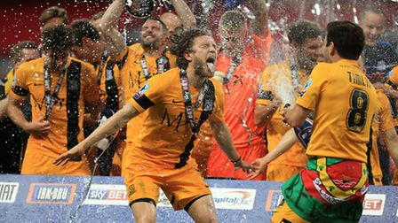 Ben Coker (left) and Michael Timlin celebrates with champagne following Southend's recent victory in
