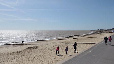 People enjoy a blustery but sunny day in Felixstowe.