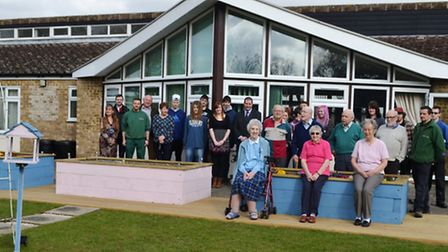 The garden at Weston Court with some of the residents and the Inspire Suffolk Team students who comp
