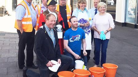 Volunteers from Bury in Bloom clean up Bury St Edmunds Town Centre in preparation for the Anglia in
