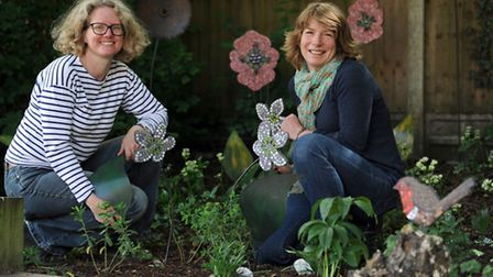 The new garden at St Peter's nursing home in Bury is unveiled. Liz Cooke (left) and Jacqui Campbell,