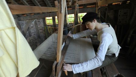The Kentwell Hall wool day in Long Melford. Tim Jenkins 'Tom Tymn' at work weaving.