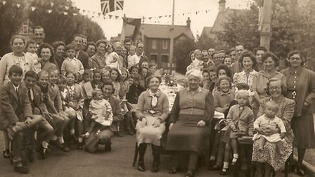 Victory in Europe celebrations in Norman Crescent, Ipswich. Elizabeth Greenhalgh is the little girl