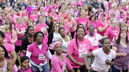 Race for Life participants warm up at Trinity Park on Sunday, June 14.