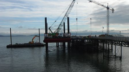A file photograph Red7 Marine's barge Haven Seariser 2 at work on alongside Mumbles pier in South Wa
