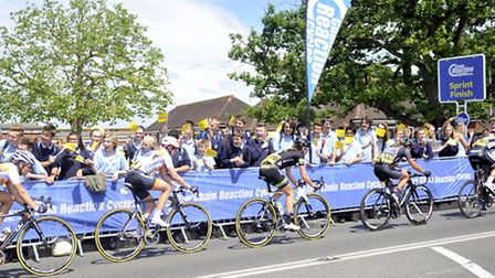 Pupils from Kesgrave High School cheer on the Aviva Women's Tour as they pass the school on Wednesda