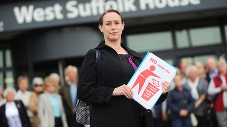 Sarah Bartram arrives at West Suffolk House with her supporters to hand over the Hollow Road Farm wa
