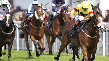 Adam Kirby on Slip Sliding Away (yellow silks) wins the Allens of Petworth Stakes during day three o