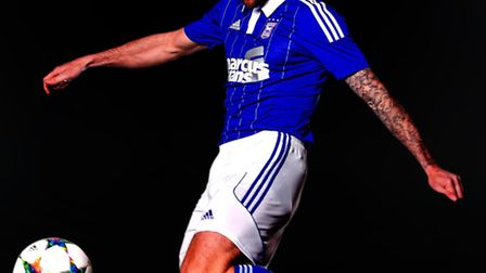 Daryl Murphy models Ipswich Town's new home kit for the 2015/16 season.