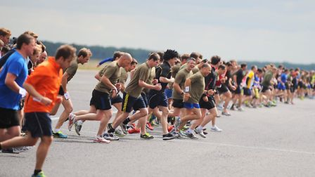 Personnel from RAF Honington gather on the airfield in order to attempt to break the Guinness World