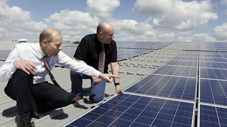 Denny Bros 'Print and Save' Campaign: Julian Colman and MD Graham Denny survey the new solar roof p