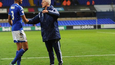 Mick McCarthy congratulates Tyrone Mings on the pitch
