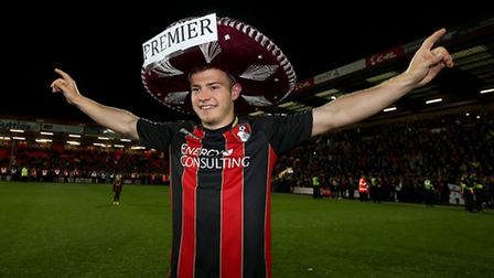 Ryan Fraser celebrates promotion with AFC Bournemouth.