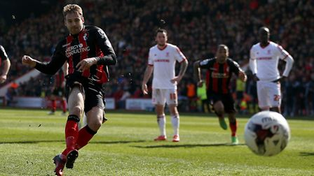 Brett Pitman scores from the penalty spot for Bournemouth.